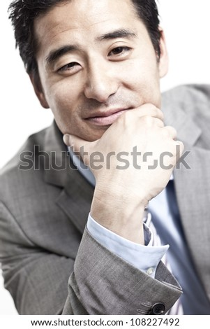 business man smiles at you on white background