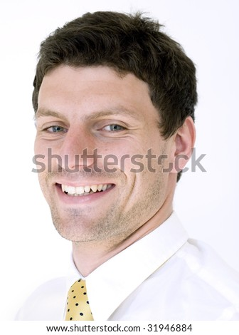 Business man smiles while wearing white shirt