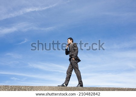business man Speaking into Cell-phone