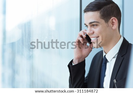 Business man speaking on mobile phone - stock photo