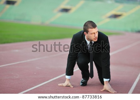 business man sport manager and executive at soccer ball athletic stadium and race track - stock photo