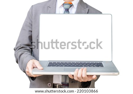 Business man stand  with laptop computer facing the camera and showing you something on laptop. - stock photo