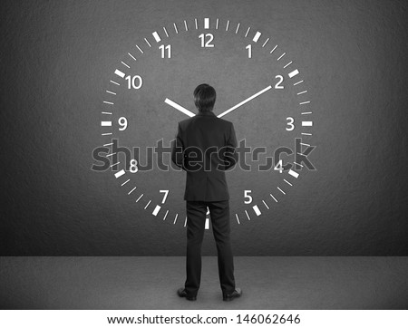 Business man standing and times - stock photo