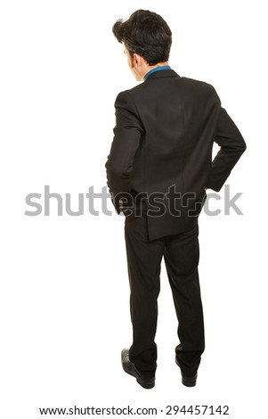 Business man standing from behind with both hands in his pockets