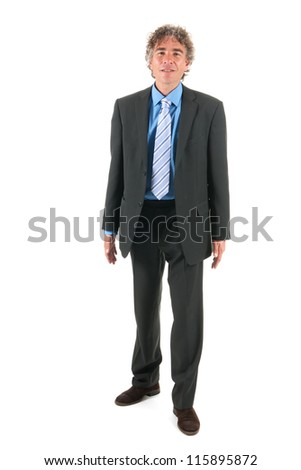 Business man standing in the studio isolated over white background
