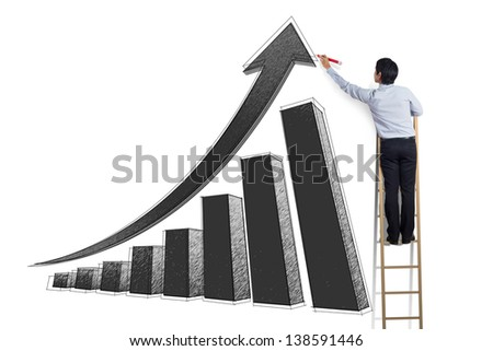 business man standing on ladder drawing growth chart on wall - stock photo