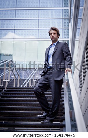 Business man standing outside his office - stock photo