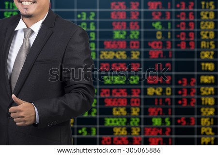 business man standing with stock market background
