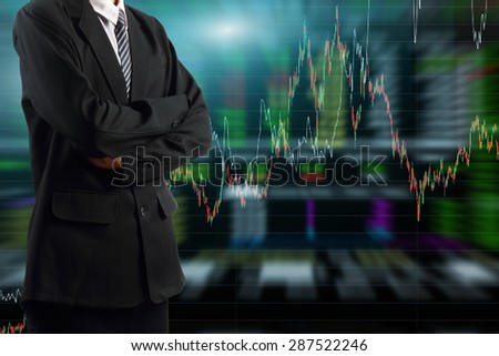 business man standing with stock market graph background - stock photo