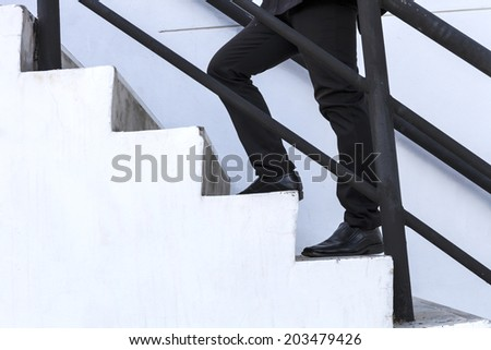 business man step up on stair, success, - stock photo
