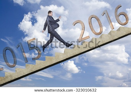 Business man stepping up on stairs to gain her success from 2015 in 2016 new year against blue sky with clouds Full length running up businessman  - stock photo