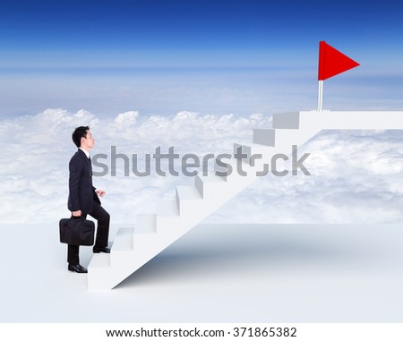 Business man stepping up on stairs to red flag with cloud and sky background (business success concept) - stock photo