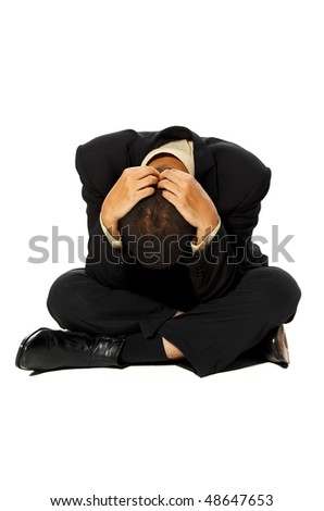 Business man stress and sitting on isolated white background - stock photo