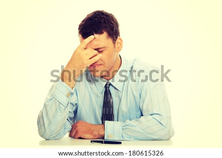 Business man stress or depression isolated on white background - stock photo