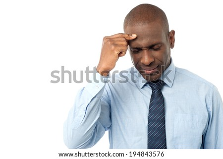 Business man suffering from stress and a headache - stock photo