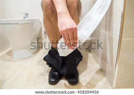 business man taking the role of soil in a toilet - stock photo
