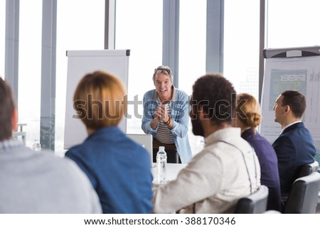Business man talking about project during meeting in modern office.