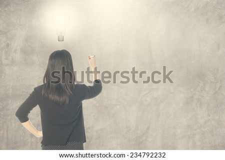 Business man thinking idea bulb and writing on blank wall for text and background - stock photo