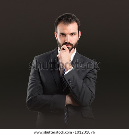 business man thinking over black background