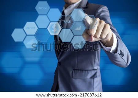 Business man touch modern interface for invesment on blue background. - stock photo