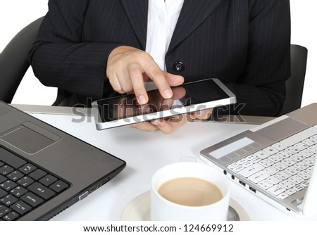 business man touch tablet working two notebook and hot coffee on white table