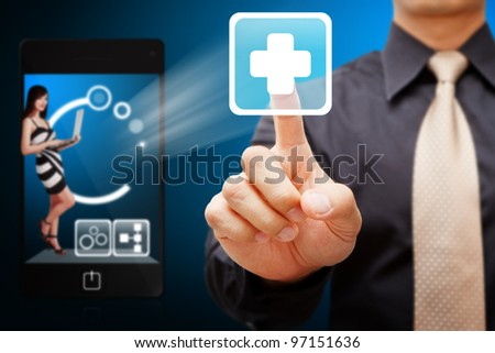 Business man touch the First Aid icon from mobile phone - stock photo