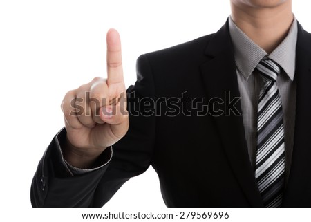 Business man touching an imaginary screen against white background - stock photo