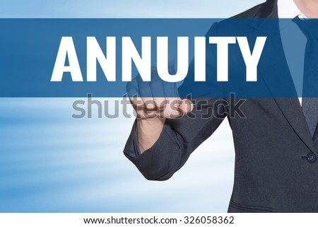 Business man touching Annuity word on blue virtual screen - stock photo