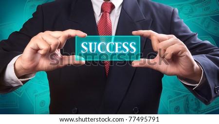 Business man touching success button - stock photo