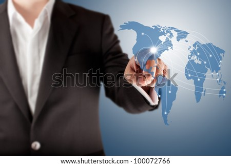 Business man touching world map screen for connectivity concept - stock photo