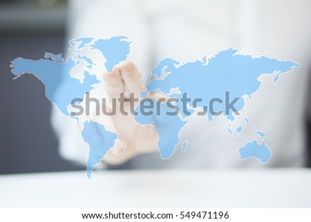 business man tucing in the world map
