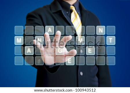 "Business man typing the word ""management"" on a virtual keyboard"