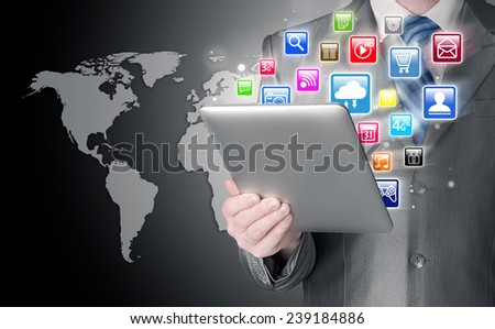 Business man use tablet pc with colorful application icons - stock photo