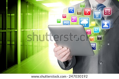 Business man use tablet pc with colorful application icons in office - stock photo