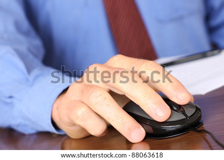 Business Man using a Computer mouse - stock photo