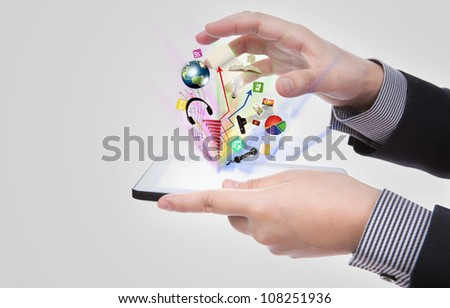 Business man using a touch screen device against white background (Elements of this image furnished by NASA) - stock photo