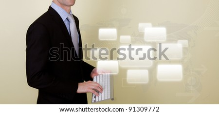 Business man using a wireless keyboard for presentation