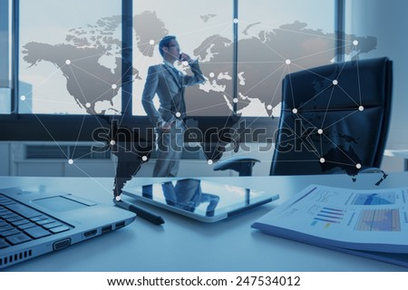 business man using cell phone in office, business globalization concept - stock photo