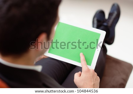 Business man using digital tablet pc with green screen for internet and email - stock photo