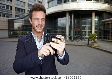 Business man using navigation app in smartphone in urban city - stock photo