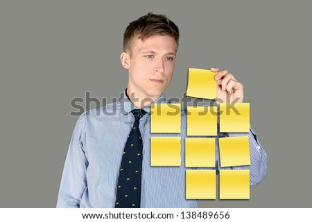 Business man using post it notes - stock photo