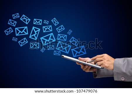 business man using tablet computer and email icons - stock photo