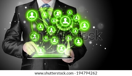 Business man using tablet PC social connection