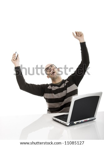 Business man very happy with great news, with both arms in the air