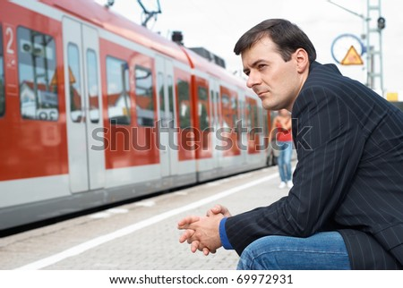 Business man wait for a train