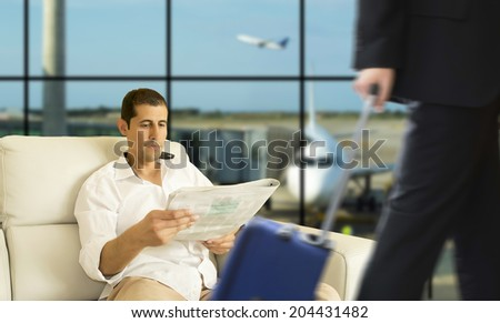 Business man waiting for his flight in the VIP area - stock photo