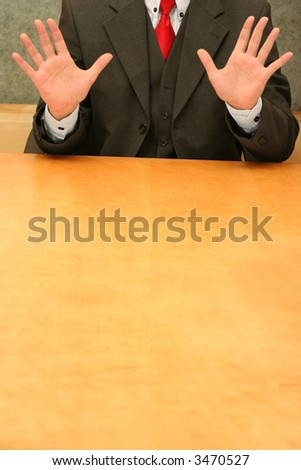Business-man waiting sitting at the desk, open hands. - stock photo
