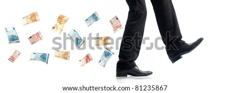 Business man walking, bank note following - stock photo