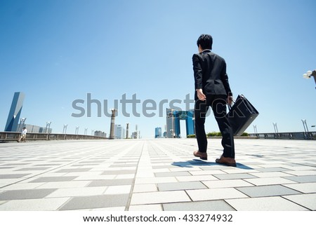 business man walking on the road                                - stock photo