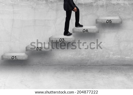 business man walking step by step of business to success  - stock photo
